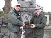 David Dumican receives the trophy for the first fish caught on the fly. Sponsored by Ken Tucker